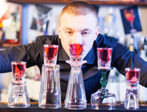 Barman making cocktail drinks Royalty Free Stock Images