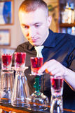 Barman making cocktail drinks Royalty Free Stock Photo
