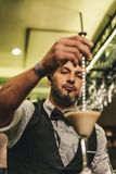 Barman is making cocktail at night club. Expert barman is making cocktail at night club Stock Image