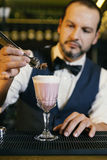 Barman is making cocktail at night club Royalty Free Stock Images