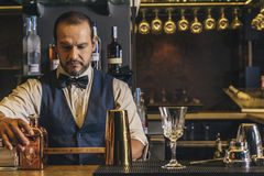 Barman is making cocktail at night club Royalty Free Stock Photos