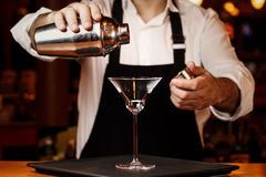 Barman in making cocktail at a nightclub. Nightlife concept. No Royalty Free Stock Images
