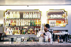 Barman making cocktail Stock Images