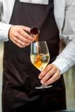 Barman making cocktail Royalty Free Stock Image