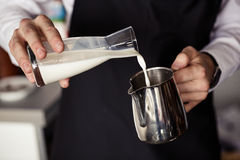 Barman making coffee, pouring milk Royalty Free Stock Photo