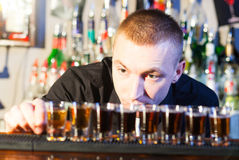 Barman making  drink shots Stock Photo