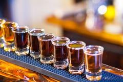 Barman making  drink shots Royalty Free Stock Images
