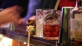 Barman making drinks in bar stock video