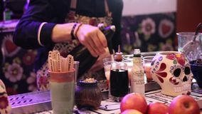 Barman making drinks in bar. MOSCOW, RUSSIA - SEPTEMBER 09, 2015: Barman making cocktail drinks in bar close up process stock video footage