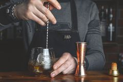 Barman with a cocktail stock images