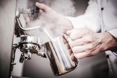 Barman Milk Steaming images stock