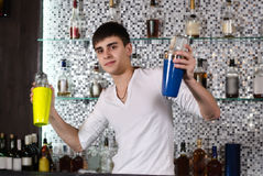 Barman mixing cocktails at the bar Stock Photos
