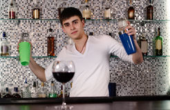 Barman mixing cocktails at the bar Stock Photography