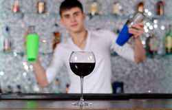 Barman mixing cocktails at the bar Stock Images
