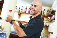 Barman portrait holding a glass of wine Royalty Free Stock Image