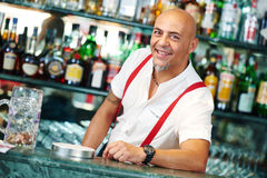 Barman portrait standing near bartender desk in restaurant bar Stock Photography