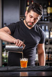 Barman pouring alcohol Royalty Free Stock Image
