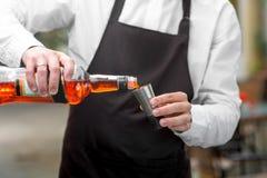 Barman pouring Aperol Stock Photo