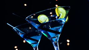 Barman pouring blue cocktail drink on a disco bar table, club atmosphere stock video