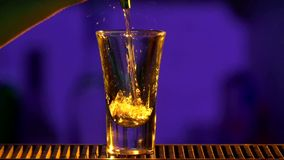 Barman pouring clear alcohol liquid with splash stock video
