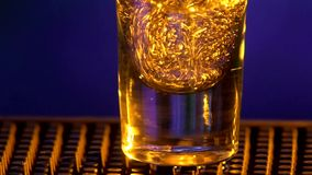 Barman pouring clear alcohol liquid with splash stock footage