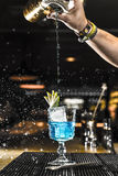 Barman pouring a cocktail into a glass Stock Photography