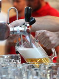 Barman pouring draught beer Royalty Free Stock Photos