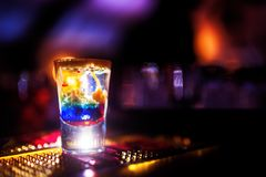 Barman pouring a shot of liquor into glasse Stock Image
