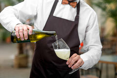 Barman pouring sparkling wine Royalty Free Stock Photos