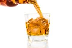 Barman pouring whiskey on white background Stock Photo