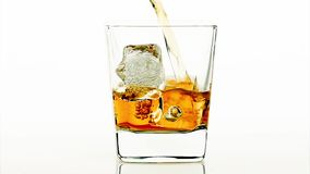 Barman pouring whiskey on white background, whisky relax time stock video