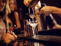 Barman Serving Cocktail Drinks Stock Photo