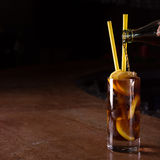 Barman prepares Cuba libre cocktail in a tall glass Stock Image
