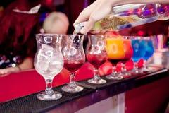 Barman  prepares exotic cocktails Stock Image