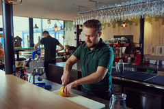 The barman prepares fresh juice at bar. stock image