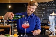 Barman preparing alcoholic cocktail for customer Royalty Free Stock Image