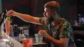 Barman preparing cocktail on bar. Barman preparing cocktail in the bar, slow motion stock footage