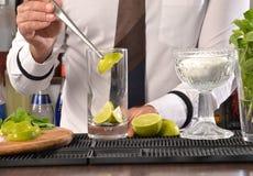 Barman preparing cocktail Royalty Free Stock Photos