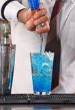 Barman preparing cocktail Stock Images