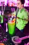 Barman professional making cocktail royalty free stock image