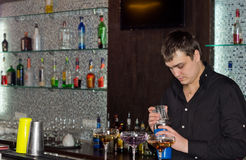 Barman in a pub preparing alcoholic cocktails stock image