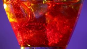 Barman puts ice and pours liquid and sweet syrup stock footage