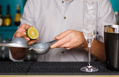 Barman's hands making cocktail with egg yolk royalty free stock image
