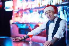 Barman in Santa cap Stock Images