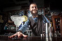 Barman serving cocktail. Royalty Free Stock Photos