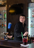 Barman serving a customer Royalty Free Stock Images