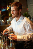 Barman Serving Drinks In Nightclub Royalty Free Stock Image