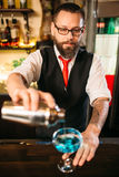 Barman with shaker making alcohol cocktail Stock Photography