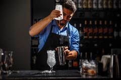 Barman with shaker Stock Photography