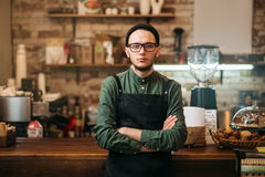 Barman standing against bar counter Stock Photo